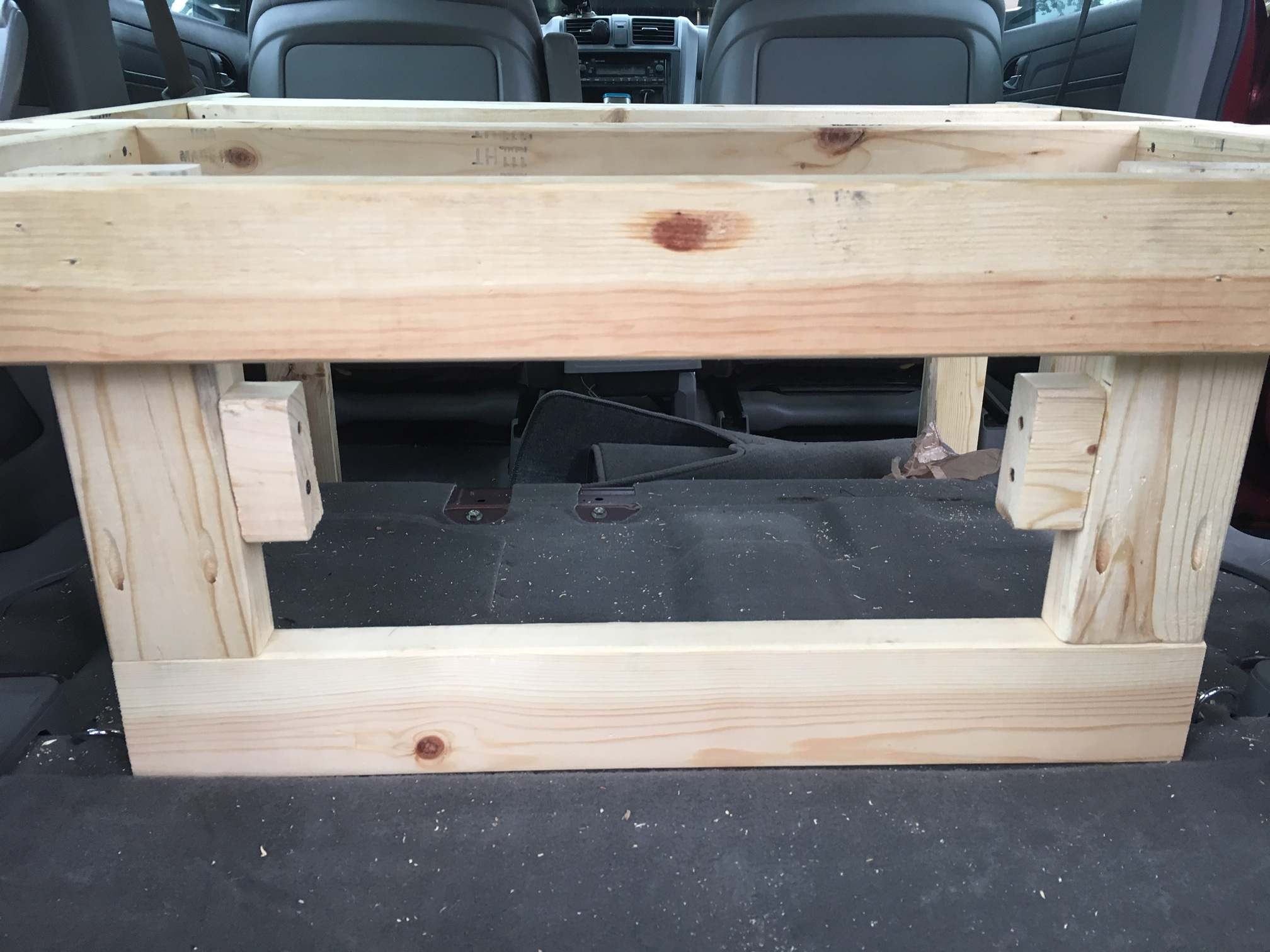 Separating the front and back space below the platform and adding some more strength